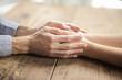 Tenderly holding hands