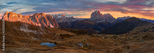 Foto auf Leinwand Schokobraun Selva di Val Gardena, Scenic mountain landscape, Italian Dolomites with dramatic sunset and cloudy sky at background.