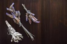 Sage Smudge With Lavender Bundles On Dark Wood Table