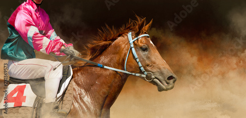 Photo Jokey on a thoroughbred horse runs on color background