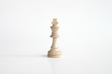 White King Chess Piece In White Isolated Background