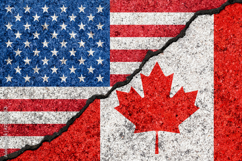 Spoed Foto op Canvas Canada Flags of USA and Canada painted on cracked grunge wall background/Canada and USA relations concept