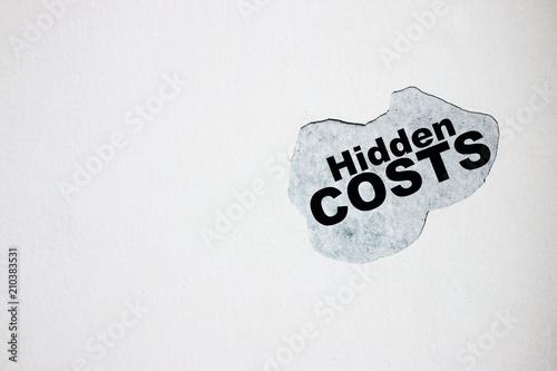 Fotografía  Hidden costs On the broken wall.