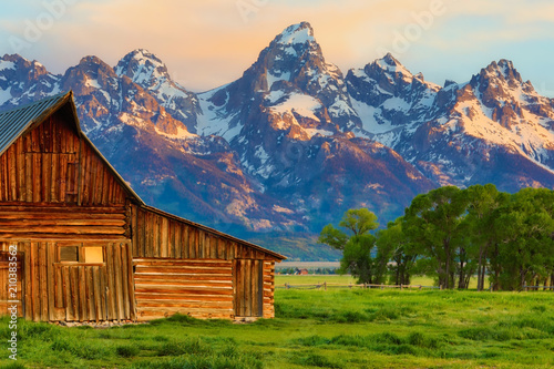 fototapeta na lodówkę This abandoned, vintage barn in Mormon Row has the Grand Tetons in the background. Located in Jackson Hole, Wyoming, it is listed on the National Register of Historic Places.