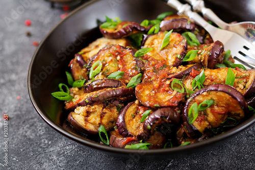 Fotografering Eggplant grilled with tomato sauce, garlic, cilantro and mint