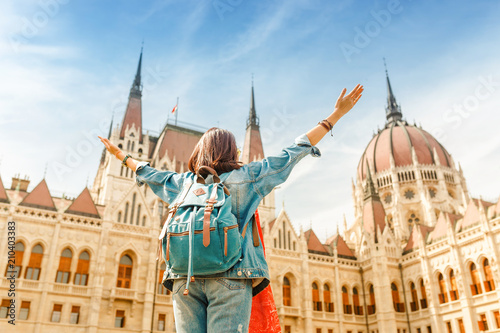 Foto auf Gartenposter Budapest Happy asian casual woman student enjoying great view of the Parliament building in Budapest city, travel in Europe concept