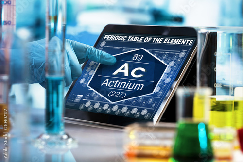 researcher working on the digital tablet data of the chemical element Actinium A Wallpaper Mural