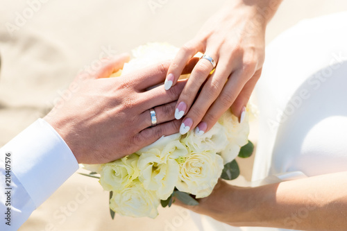 Aluminium Prints Manicure Young woman with bouquet of flowers on the beach.