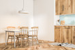White and wooden Scandi style dining room corner
