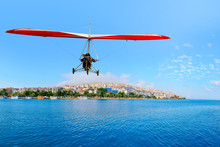 The Motorized Hang Glider  Flying Over The City