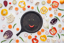 Top View Of Smiley Face From Green Peas And Red Pepper On Round Wooden Board Isolated On White