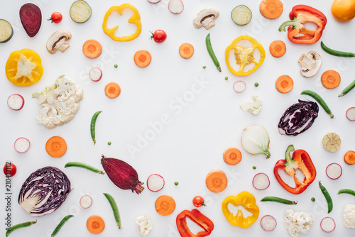 top view of fresh sliced healthy vegetables isolated on white background