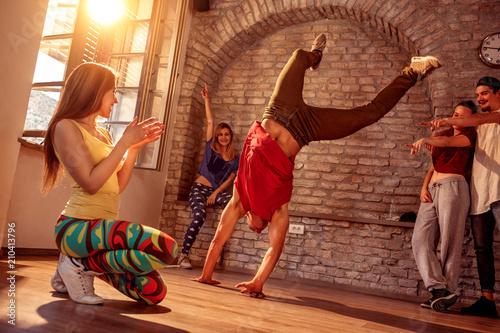 Fotografie, Obraz  Street artist break dancing performing moves