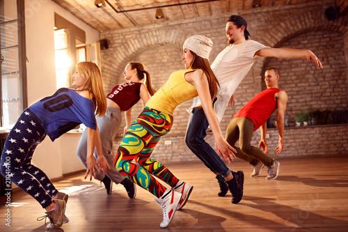 Group of dancers dancing indoor