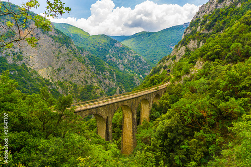 Foto op Canvas Guilin The old railway bridge of the Asopos river near village Iraklia at national park of Oiti in Central Greece