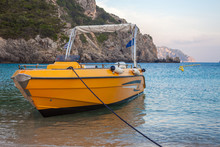 A Yellow Private Boat In The B...