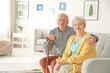 canvas print picture - Elderly couple sitting on couch in living room