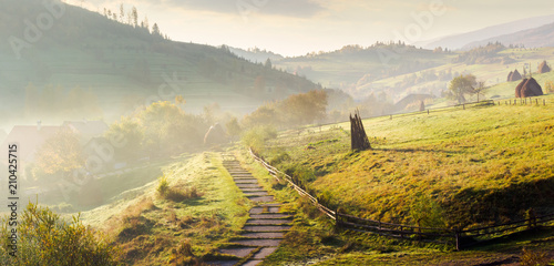 Fototapeta panorama of mountainous rural area on a hazy morning