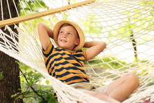 Little Boy Resting In Hammock Outdoors. Summer Camp