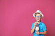 canvas print picture - Little boy with glass of milk shake on color background