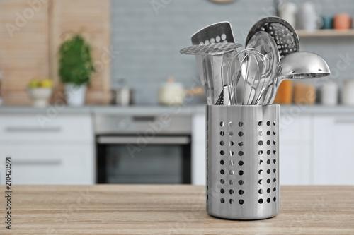 Obraz na plátne Different kitchen utensils on table