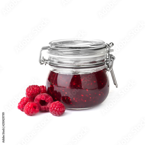 Jar with delicious raspberry jam on white background