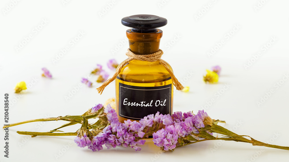 Fototapety, obrazy: Essential oil with flowers on white