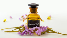 Essential Oil With Flowers On ...