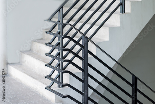 Stairway with black metallic banister in a new modern building architecture Fototapete