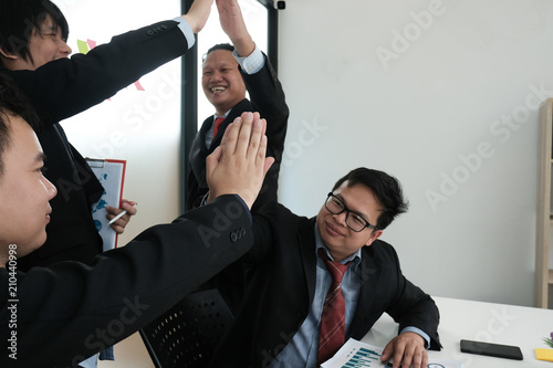 Fototapeta business co-worker team raise hands with happiness for successful project. cheerful businessman showing gladness for achievement obraz na płótnie