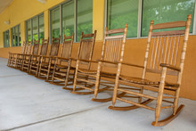 Row Of Empty Wooden Rocking Chairs, Brown, Outside Of Building - Davie, Florida, USA