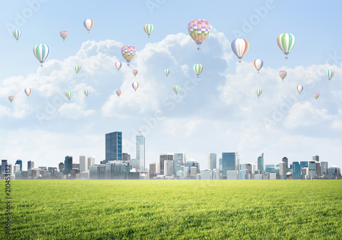 Foto op Canvas Stad gebouw Concept of eco green life with aerostats flying above city