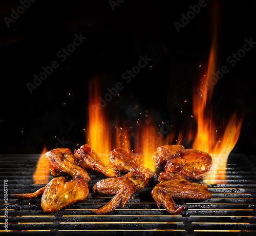 Various chicken meat being grilled, isolated on black