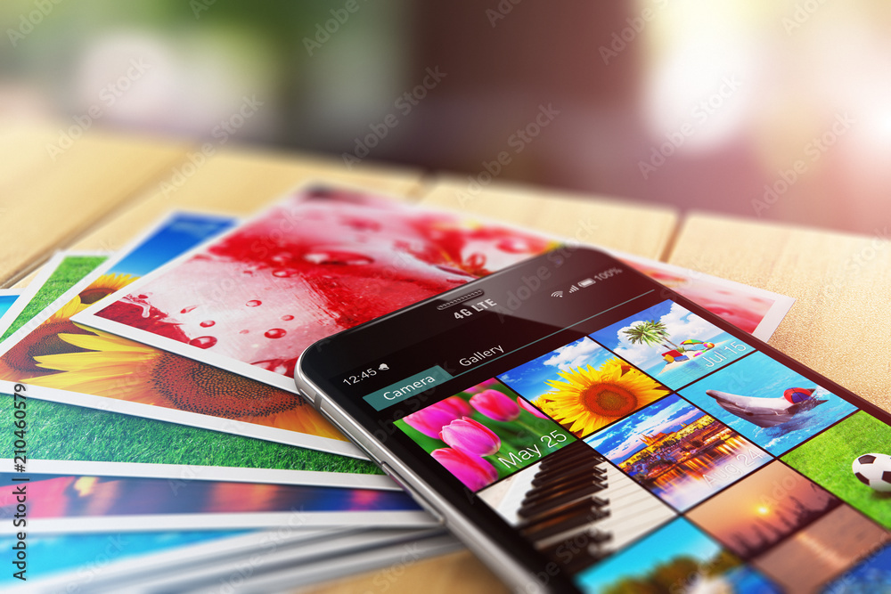 Fototapety, obrazy: Stack of photos and smartphone with image gallery app