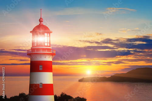 Foto auf Leinwand Leuchtturm Lighthouse light and sunset at the sea coast