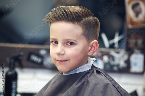 European boy in a barber shop. Ready work. Canvas Print