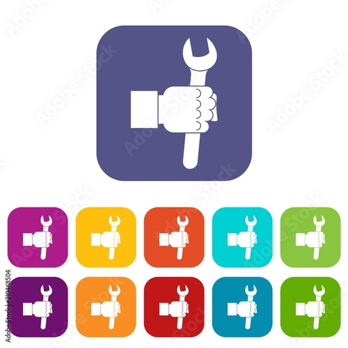 Wrench tool in man hand icons set vector illustration in flat style In colors red, blue, green and other Wall mural