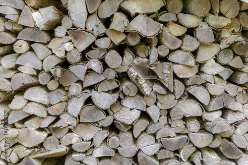 Tuinposter Brandhout textuur background of stapled firewood