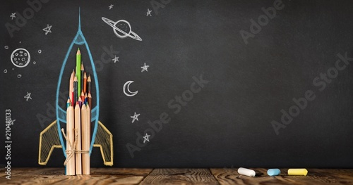 Fotografie, Obraz  Back to School Concept with Hand Drawn Rocket on Blackboard