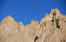 Craggy 14 Thousand Foot Peak And Blue Sky With Rising Moon In The Sangre De Cristo Mnts Of Southern Colorado.