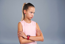Offended Kid. Cute Teenage Girl Pouting And Crossing Her Arms Across Her Chest While Looking Away From Camera