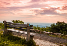 A Lone Bench Faces The Mountains Under A Stormy Sunset At High Point State Park, The Top Of NJ
