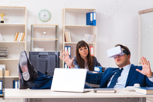 Employee with virtual reality glasses in office Canvas Print