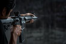 Man Holding Gun Aiming Pistol In Shooting Range