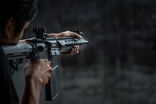 Man Holding Gun Aiming Pistol ...