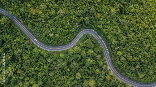 Fotografie, Obraz  Aerial view of forest road at South East Asia, Aerial view of a provincial road passing through a forest, Thailand