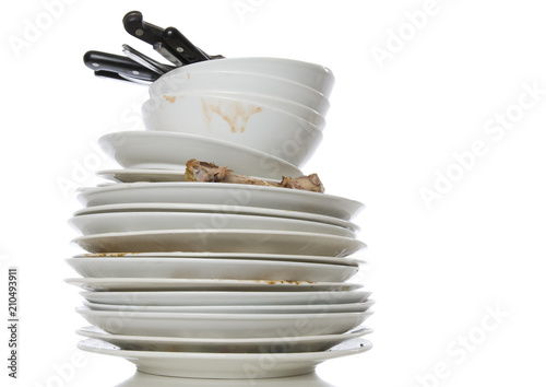 Photo A pile of dirty dishes for washing, isolated on white.