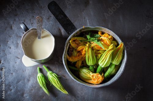Zucchini flower with pancake batterin metal table