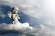 Leinwandbild Motiv Guardian angel kneeling and praying. Angel guardian on the cloud