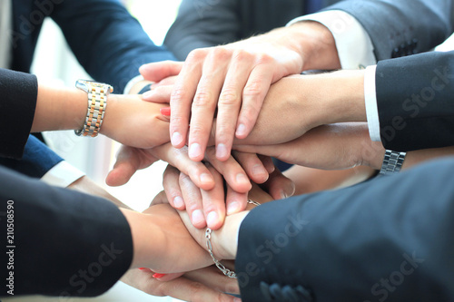 Valokuva  Group of businessman team touching hands together